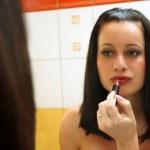 Woman making make-up herself — Stock Photo