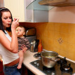 Foto Stock: Mother with son cooking