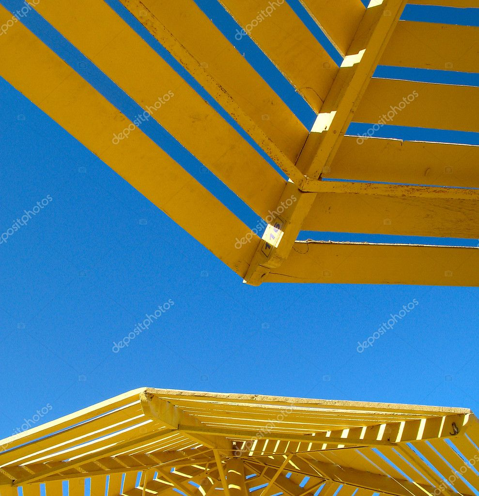 Yellow sunshade against summer blue sky in egypt  Stock Photo #2059467