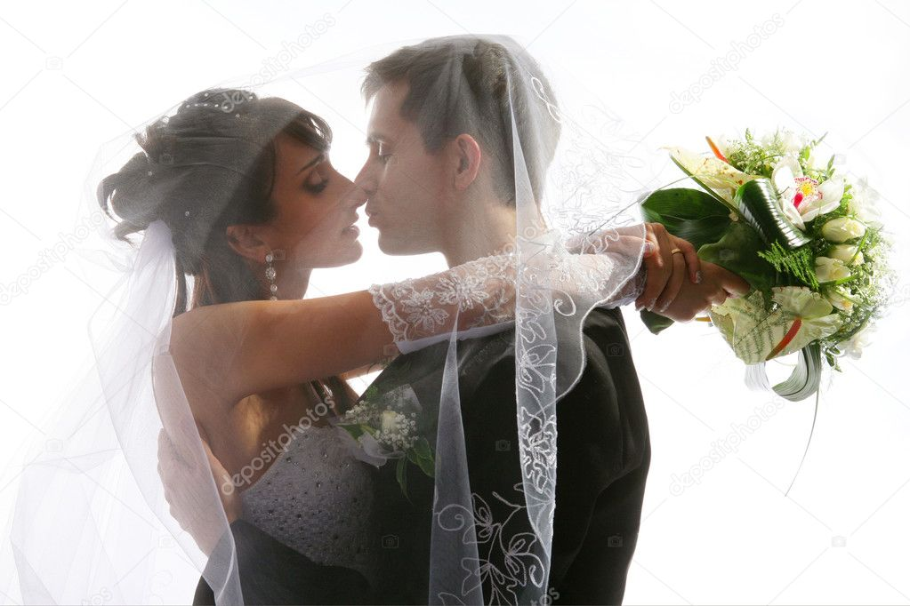 Wedding portrait of kissing just married young couple of groom and bride — Foto de Stock   #2084379