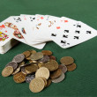 Stock Photo: Playing cards and coins