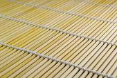 Diagonall bamboo mat texture — Stock Photo