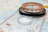 Magnetic compass on the map — Stock Photo