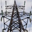 Rusty power transmissian tower - Stock Photo