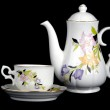 Ornate porcelain cup and teapot — Stock Photo #2107580