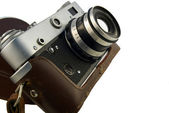 Old rangefinder in leather case — Stock Photo