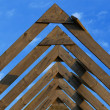 Stock Photo: Wooden roof beams under blue skies