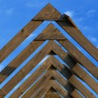 Wooden roof beams under blue skies — Stock Photo #2167003