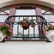 French balcony with flowers - Stock Photo
