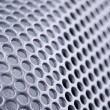Stock Photo: Curved perforated metal