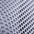 Foto Stock: Curved perforated metal