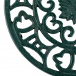Fragment of ornate cast iron trivet — Stock Photo #2167204