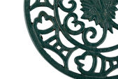 Fragment of an ornate cast iron trivet — Stock Photo