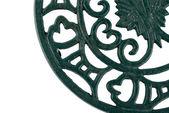 Fragment of an ornate cast iron trivet — Stock Photo