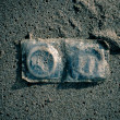 Condoms in sand — Stock Photo
