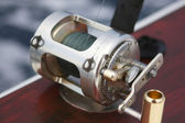 Fishing rod with reel — Stock Photo