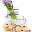 Hyacinth in glass vase with cookies — Stock Photo