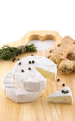 Cheese and a bundle of herbs — Stock Photo