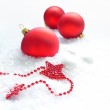Three red balls and stars in the snow — Stock Photo
