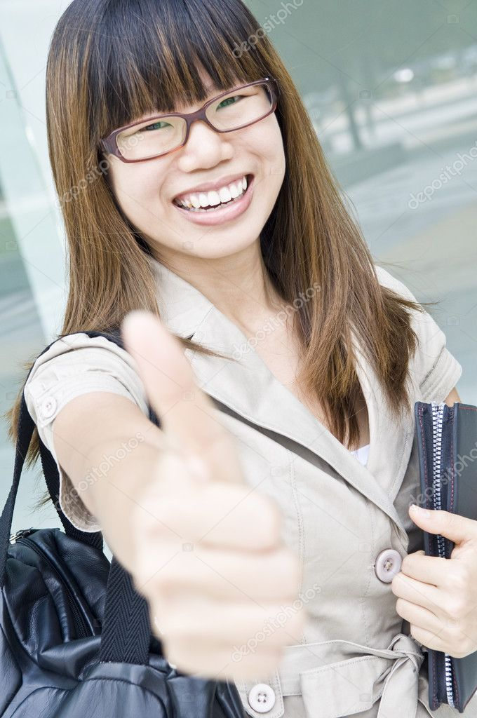 Happy asian business women with thumbs up  Stock Photo #1944227