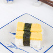 Sushi with chopstick and plate — Stock Photo