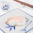 Stock Photo: Sushi with chopstick