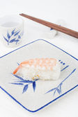 Sushi with chopstick — Stock Photo