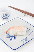 Sushi with chopstick — Stock Photo