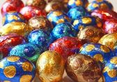 Background of colorful chocolate eggs — Stock Photo