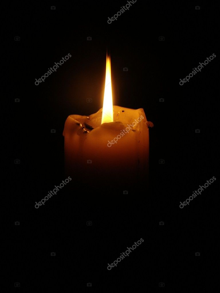 Photo shows a lighted candles on a black background. — Stock Photo #2015574