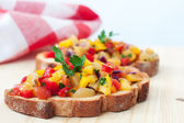 Close up of freshly prepared salsa on bread — Stock Photo