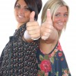 Stock Photo: Two pretty girls thumbs up
