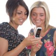 Two pretty girls with cell phone — Stock Photo