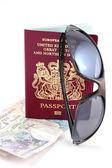Passport money and sunglasses — Stock Photo