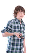 Teenage boy woth TV remote — Stock Photo