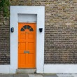Orange door — Stock Photo