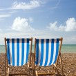 Deck chairs at the seaside — Stock Photo