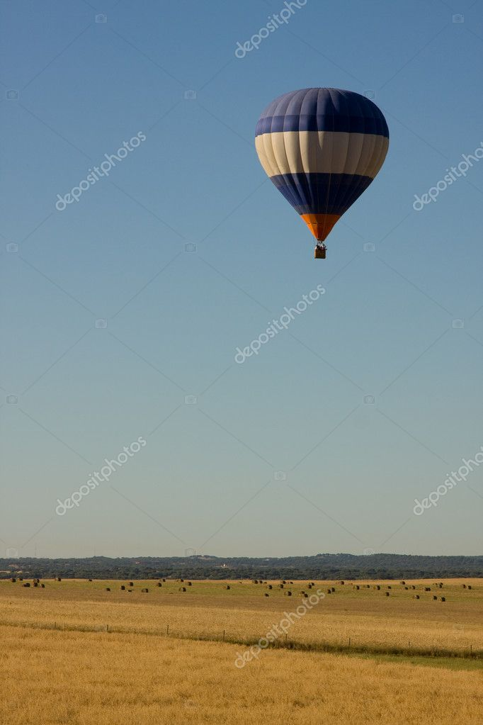 A hot air balloon over a field, with copyspace — Stock Photo #2018617