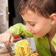 Stock Photo: Kid eating pasta