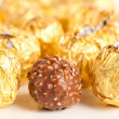 Delicious candy in golden foil - Stock Photo