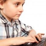 Schoolboy doing homework on laptop — Stock Photo #2007944