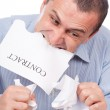 Businessman ripping apart contract — Stock Photo