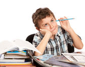 Schoolboy reluctant to doing homework — Stockfoto