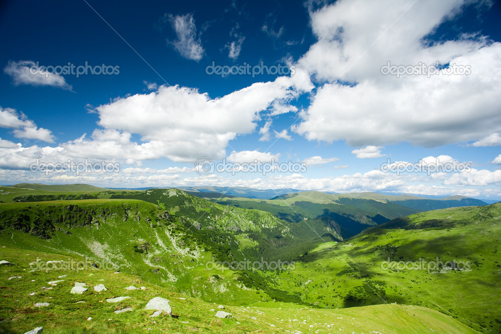 Beautiful landscape with mountains and fluffy clouds in the sky  Stock Photo #2006915