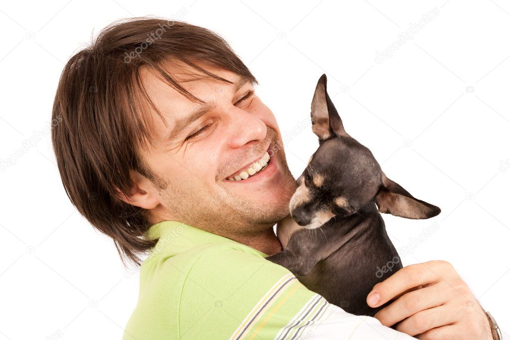 Funny portrait of a young man holding a cute chihuahua dog — Stock Photo #2007082
