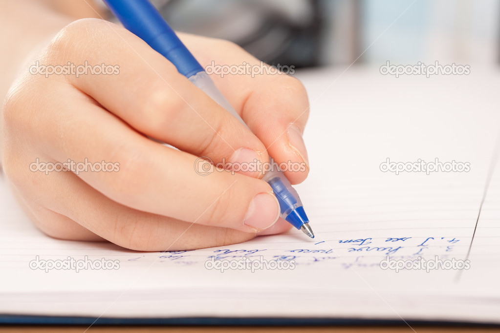Close up of a hand of a pupil writing homework or examination  Foto Stock #2007903