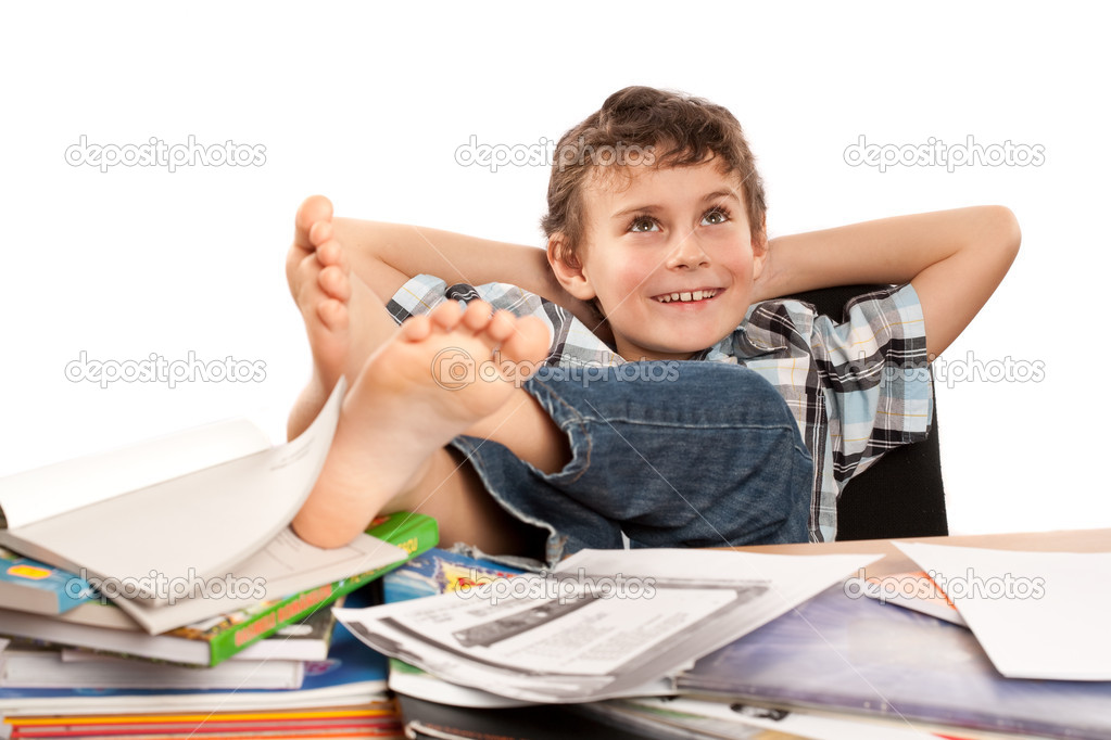 Portrait of a barefoot schoolboy with his feet up on his desk, waiting for holiday to come — Stock Photo #2007952