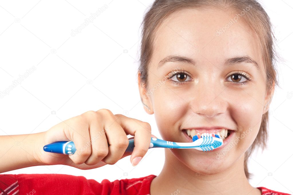 Cute young lady brushing her teeth, isolated on white — Stock Photo #2009965