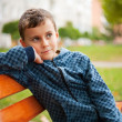 Child on a bench in a park — Stock Photo #2011506