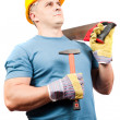 Blue collar worker with tools - Stock Photo